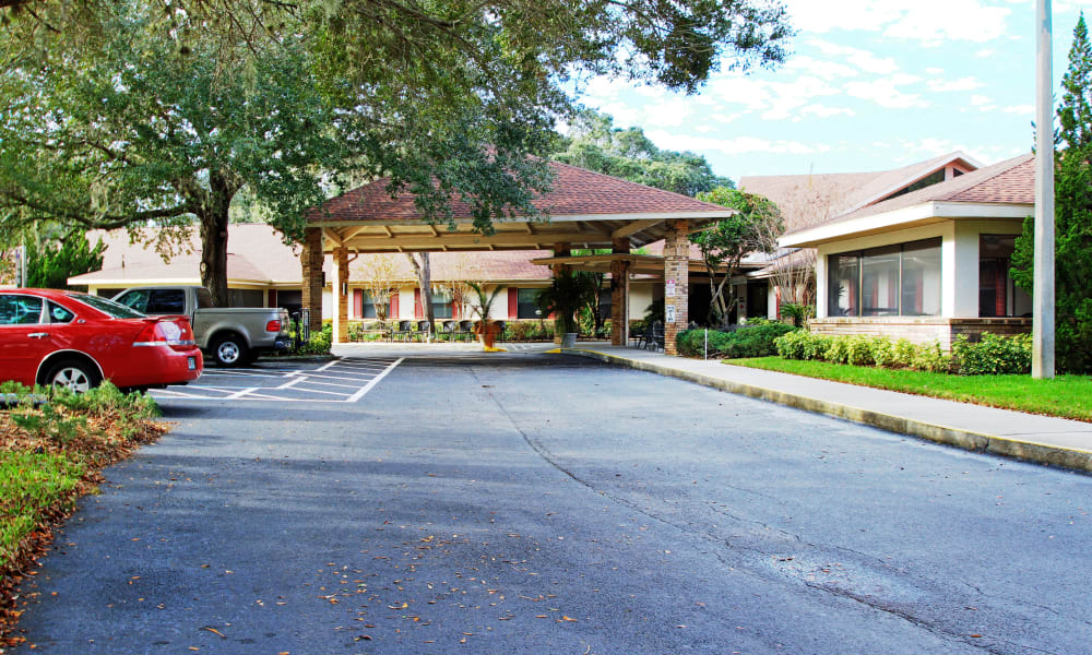 Outside of the main entrance at Forest Oaks of Spring Hill in Spring Hill, Florida
