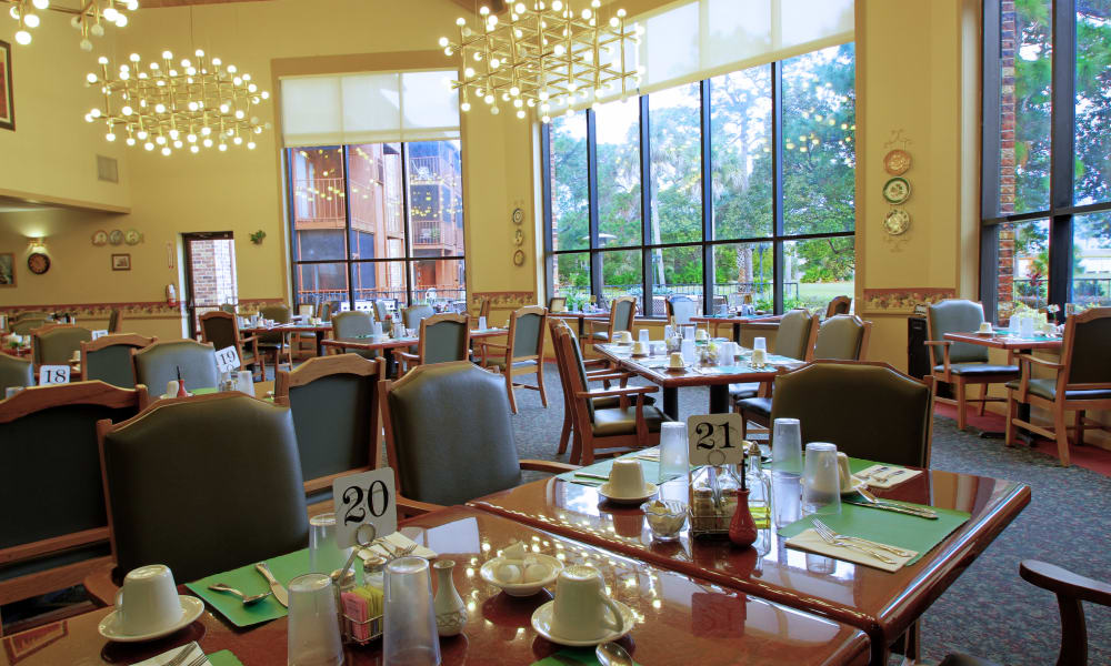 The dining hall with large windows at Renaissance Retirement Center in Sanford, Florida