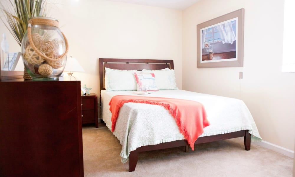 A clean, bright bedroom at Lake Morton Plaza in Lakeland, Florida