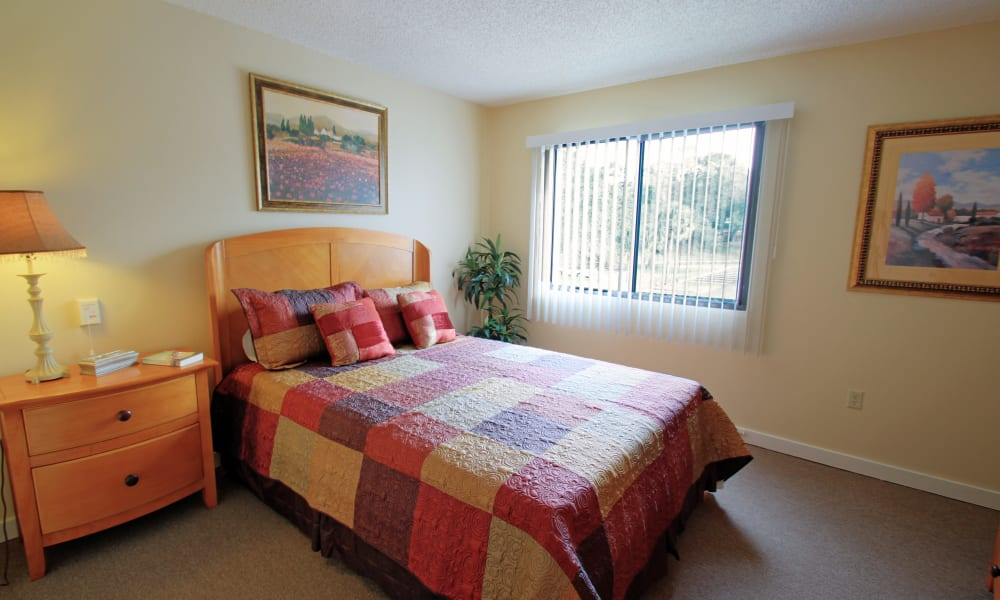 A bedroom with a window and blinds at Spring Haven in Winter Haven, Florida