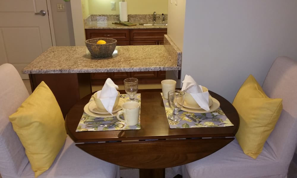 A dining room in an apartment at Gentry Park Orlando in Orlando, Florida