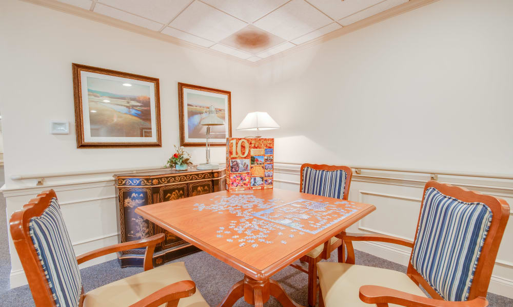 Table in the game room with 4 chairs at Villas of Holly Brook Chatham in Chatham, Illinois