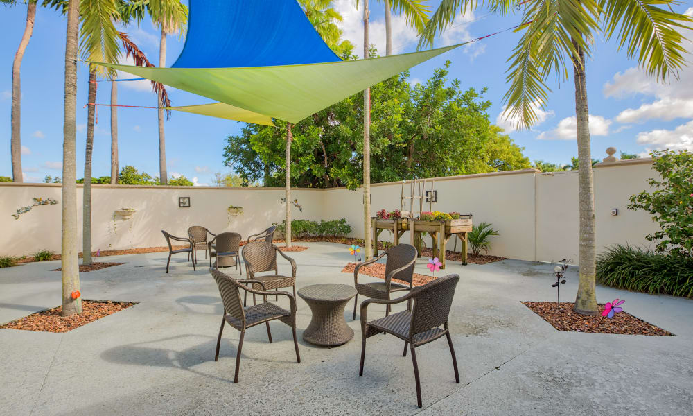 A sunny outdoor seating area at The Peninsula in Hollywood, Florida