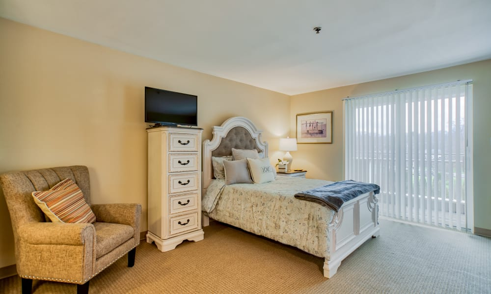 A spacious bedroom with access to a private patio at Chapel Hill in Cumberland, Rhode Island