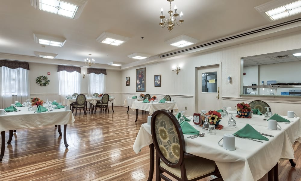 A dining hall with hardwood-style floors at Hillhaven in Adelphi, Maryland