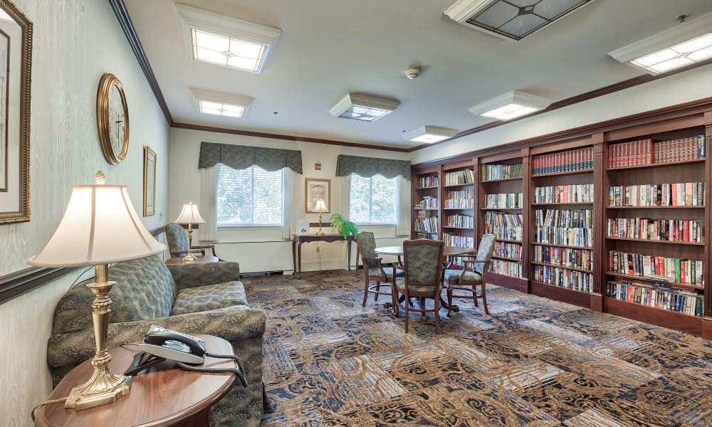 Fully stocked bookcases in a reading room at Hillhaven in Adelphi, Maryland