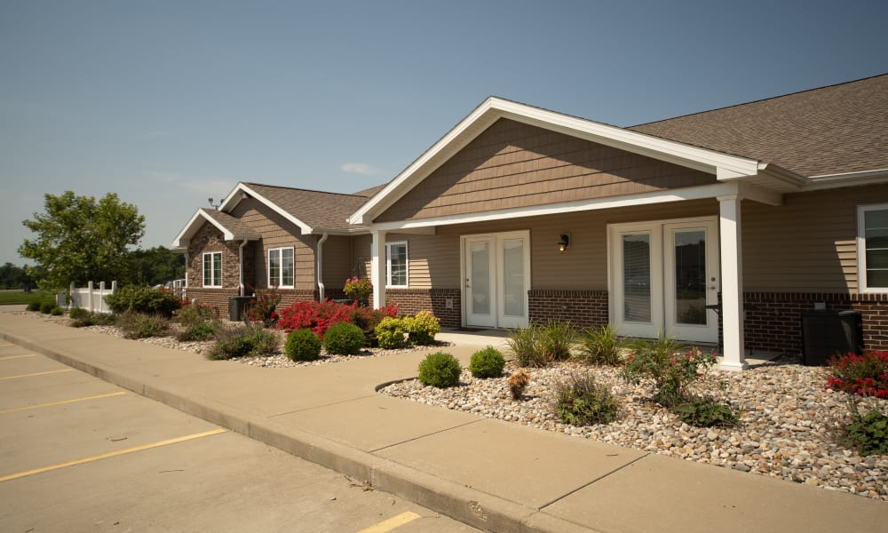 Parking in front of the homes at Villas of Holly Brook Herrin in Carterville, Illinois