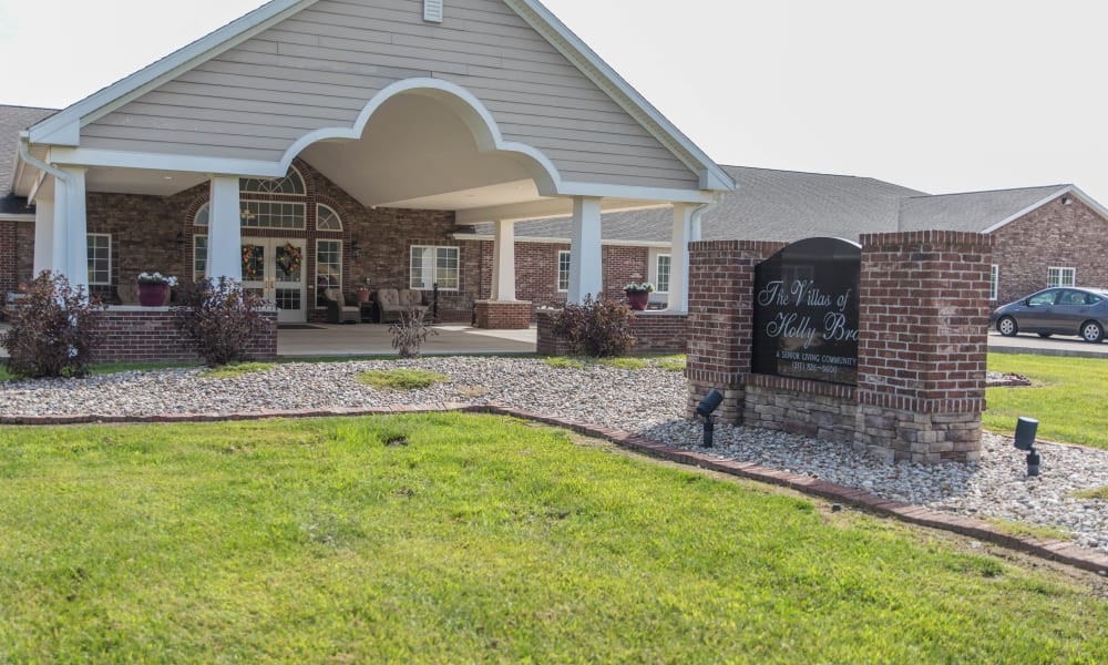 Front entrance and signage for Villas of Holly Brook Marshall in Marshall, Illinois