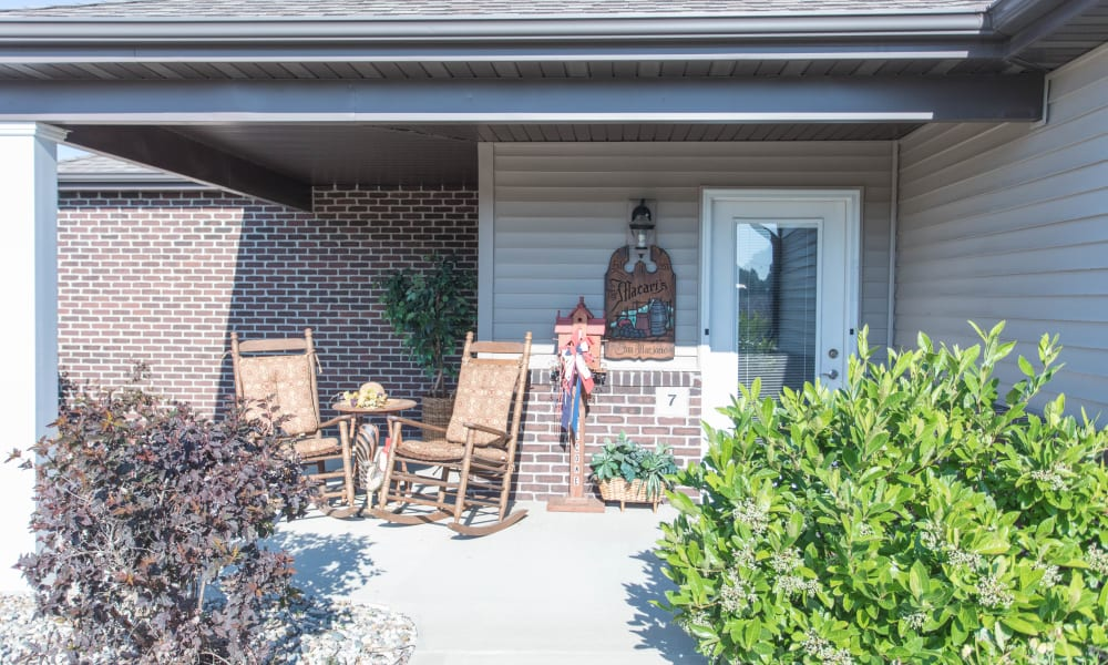 Porch with 2 rocking chairs on it at Villas of Holly Brook Shelbyville in Shelbyville, Illinois