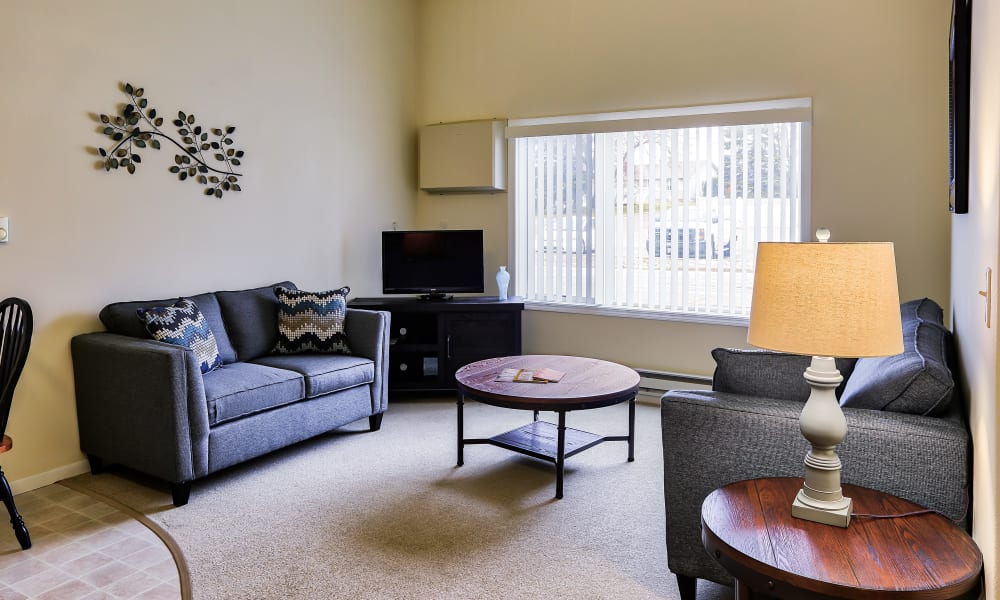 A spacious living room with a large window at The Wellington in Minot, North Dakota