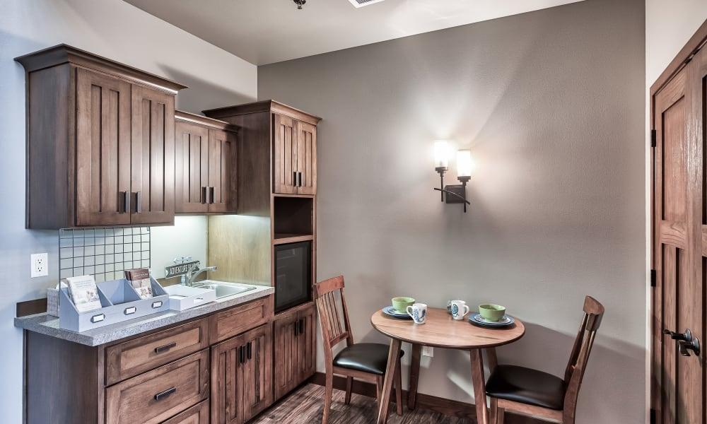 A kitchen and dining area at The Landings of Kaukauna in Kaukauna, Wisconsin