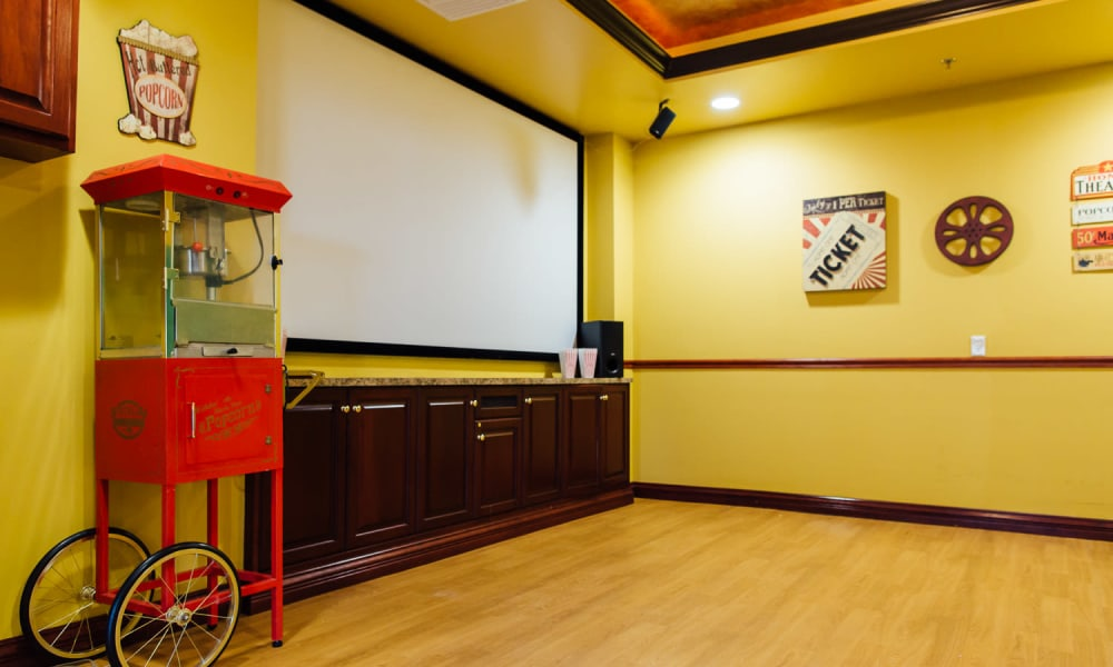 A movie room with popcorn at The Woods of Caledonia in Racine, Wisconsin