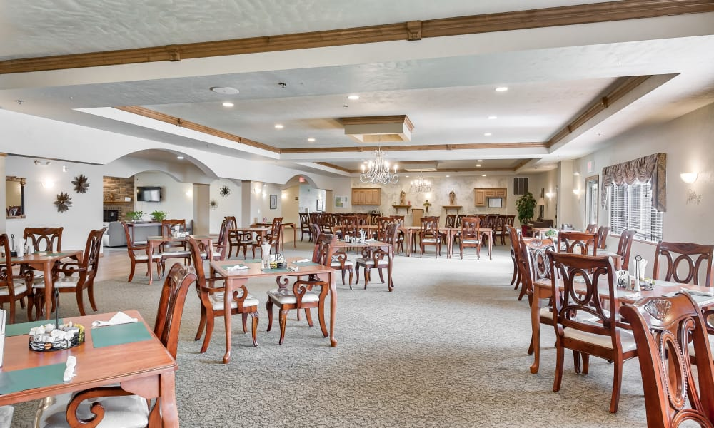The bright dining hall at Allouez Sunrise Village in Green Bay, Wisconsin