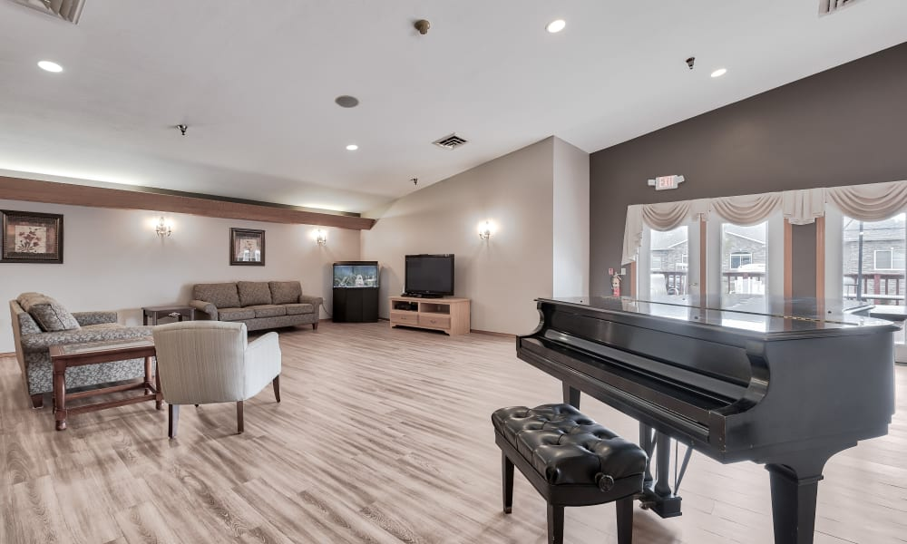 A piano in a common area at Bishop's Court in Allouez, Wisconsin