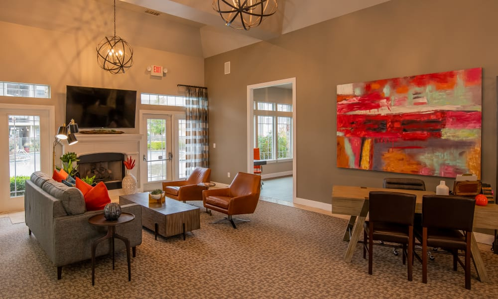 The clubhouse with plenty of seating and large tv at Colonies at Hillside in Amarillo, Texas