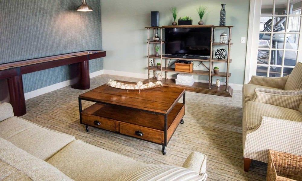 Cozy living room at Strafford Station Apartments in Wayne, Pennsylvania