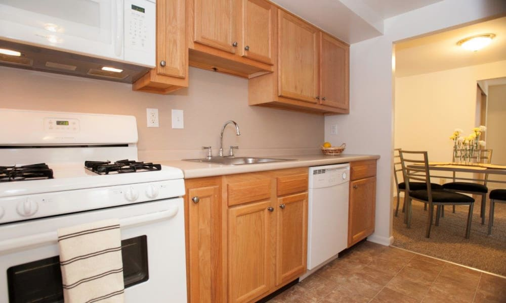 Bright kitchen with plenty of cabinet space at Strafford Station Apartments in Wayne, Pennsylvania
