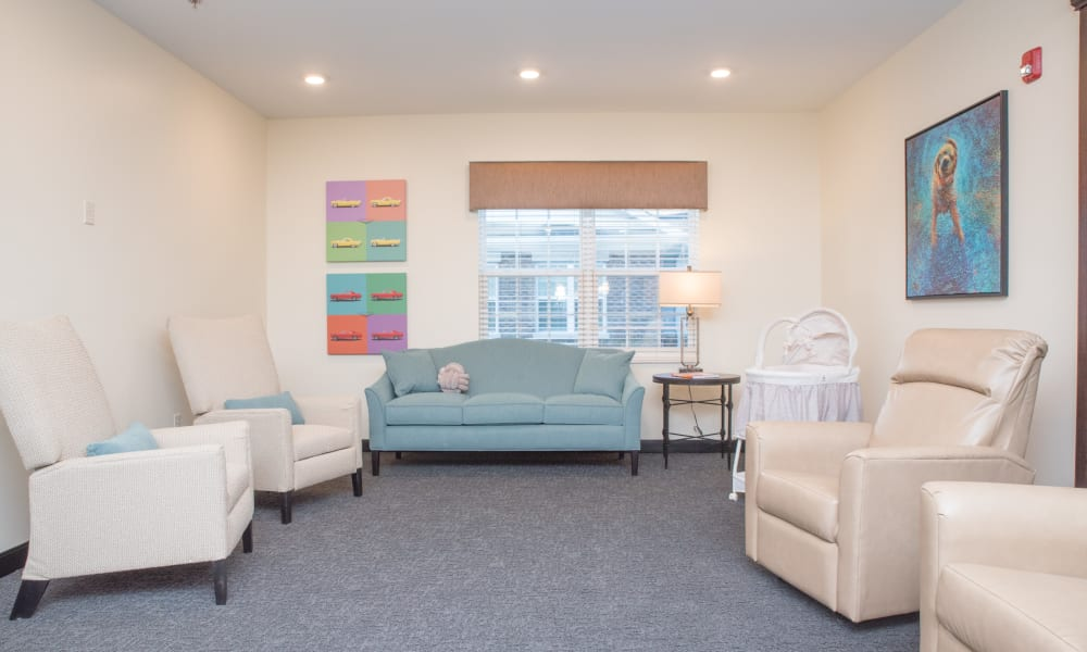 Comfortable lounge seating in a memory care room at Trilogy Health Services - Miami Township in Miami Township, Ohio