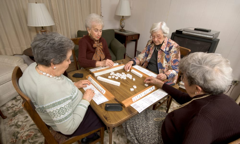 Residents playing a tabletop game at Honeysuckle Senior Living in Hayden, Idaho