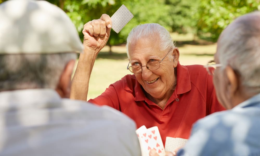 Residents playing a card game at Honeysuckle Senior Living in Hayden, Idaho