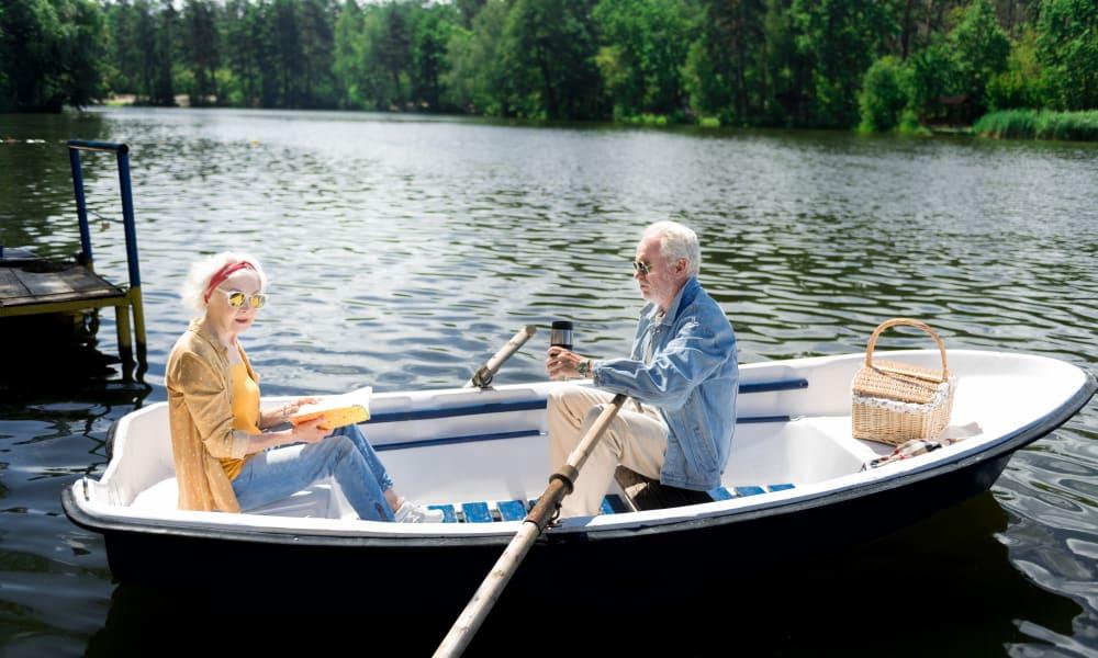 An elderly couple in a boat near Honeysuckle Senior Living in Hayden, Idaho