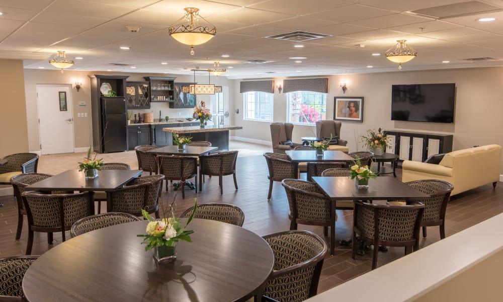 Open dining hall with hardwood floors at Inspired Living Bonita Springs in Bonita Springs, Florida