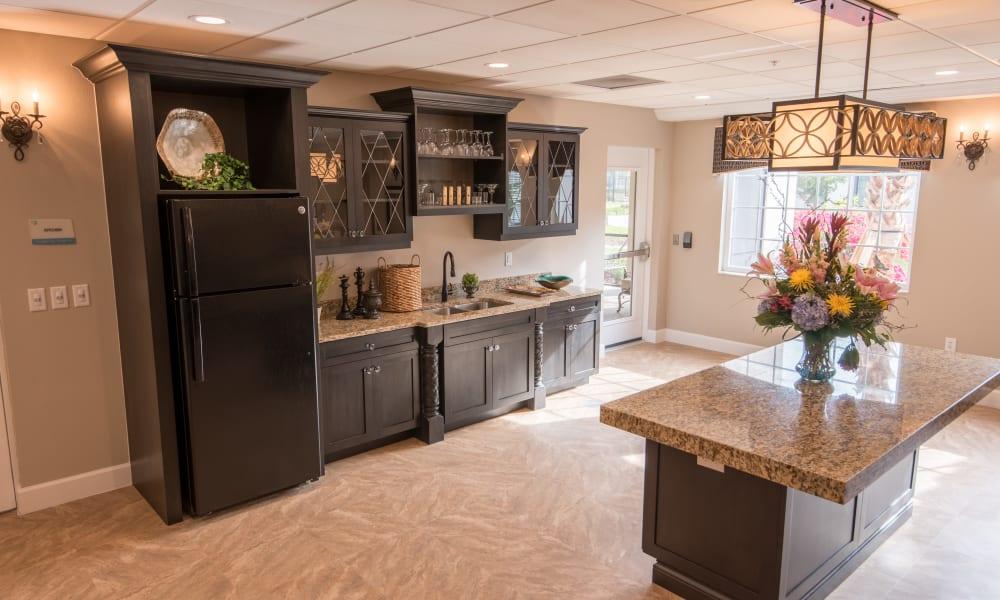 Community kitchen at Inspired Living Bonita Springs in Bonita Springs, Florida