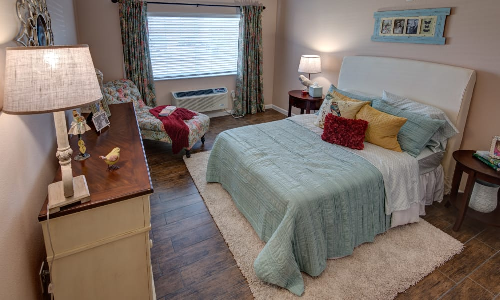 A resident bedroom at Inspired Living Hidden Lakes in Bradenton, Florida