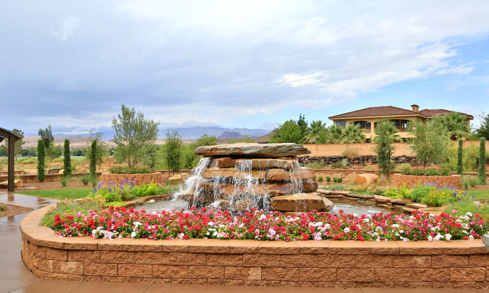 A fountain and flowers at The Retreat at Sunbrook in St. George, Utah