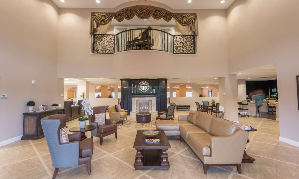 Lobby with a balcony at Inspired Living Lakewood Ranch in Bradenton, Florida.
