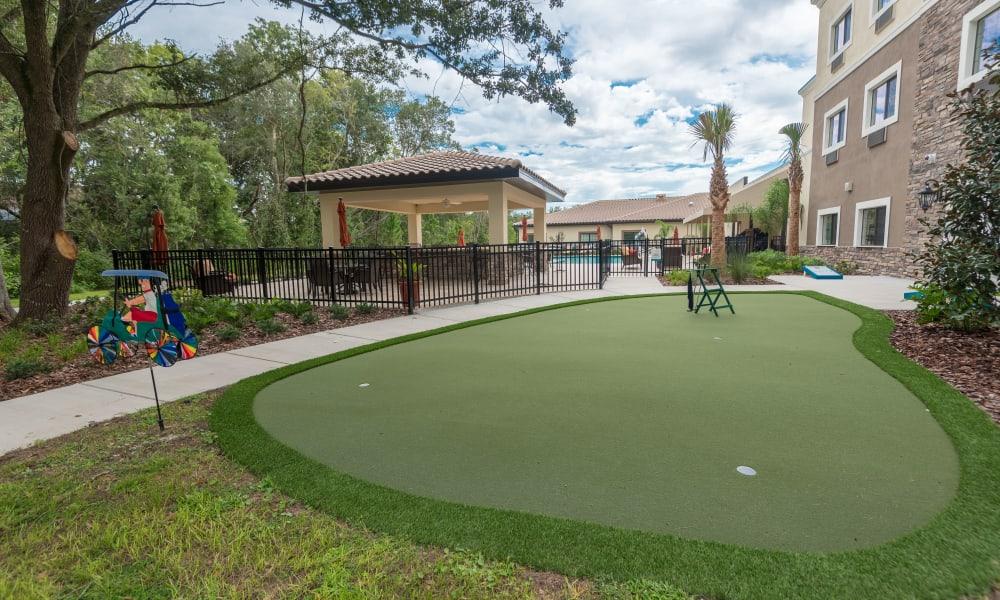 A small Putting green at Inspired Living at Royal Palm Beach in Royal Palm Beach, Florida