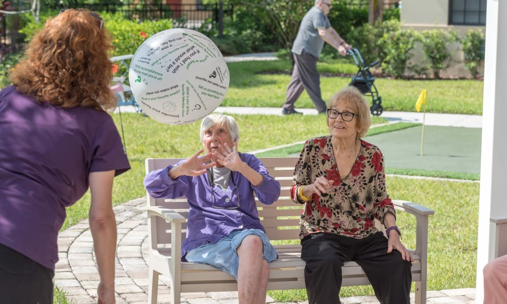 Residents playing a game outside at Inspired Living Ivy Ridge in St Petersburg, Florida.