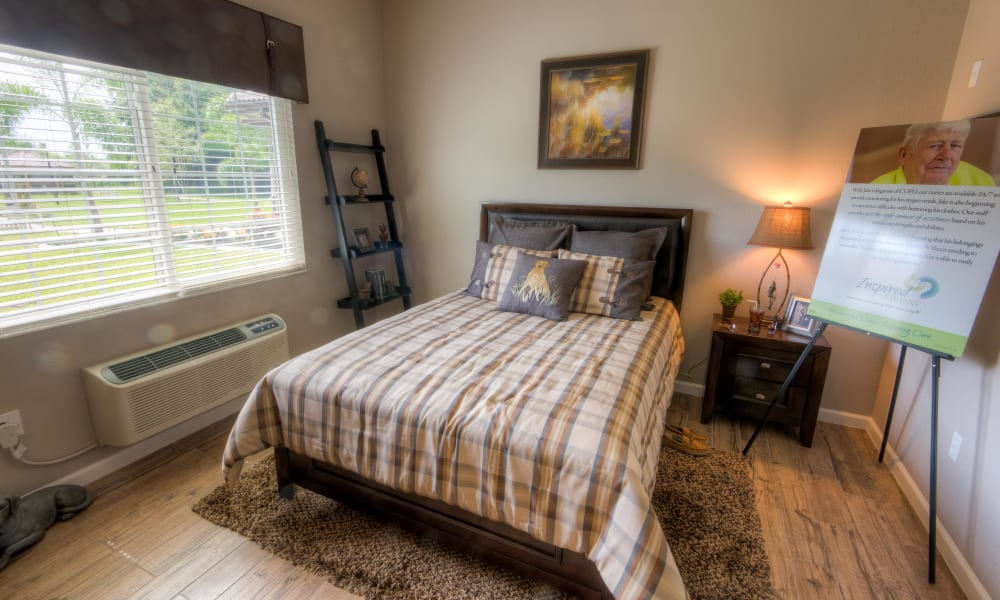A resident bedroom at Inspired Living Tampa in Tampa, Florida