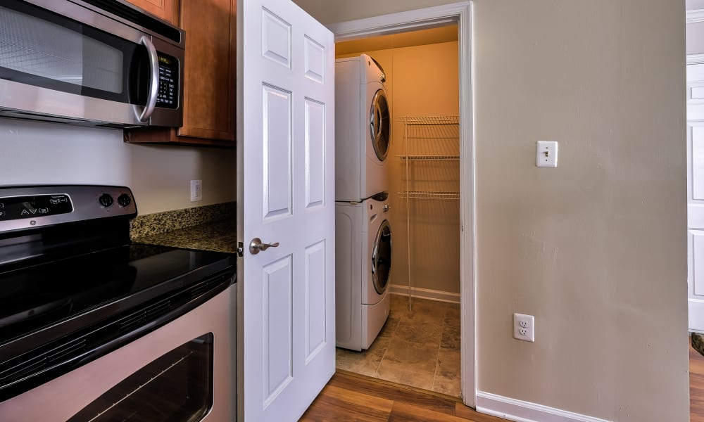 Kitchen with stainless-steel appliances & Washer & Dryer at Abbotts Run Apartments in Alexandria, Virginia