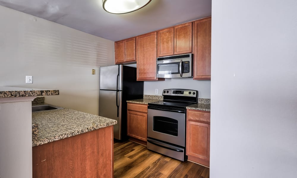 Kitchen with stainless-steel appliances at Abbotts Run Apartments in Alexandria, Virginia