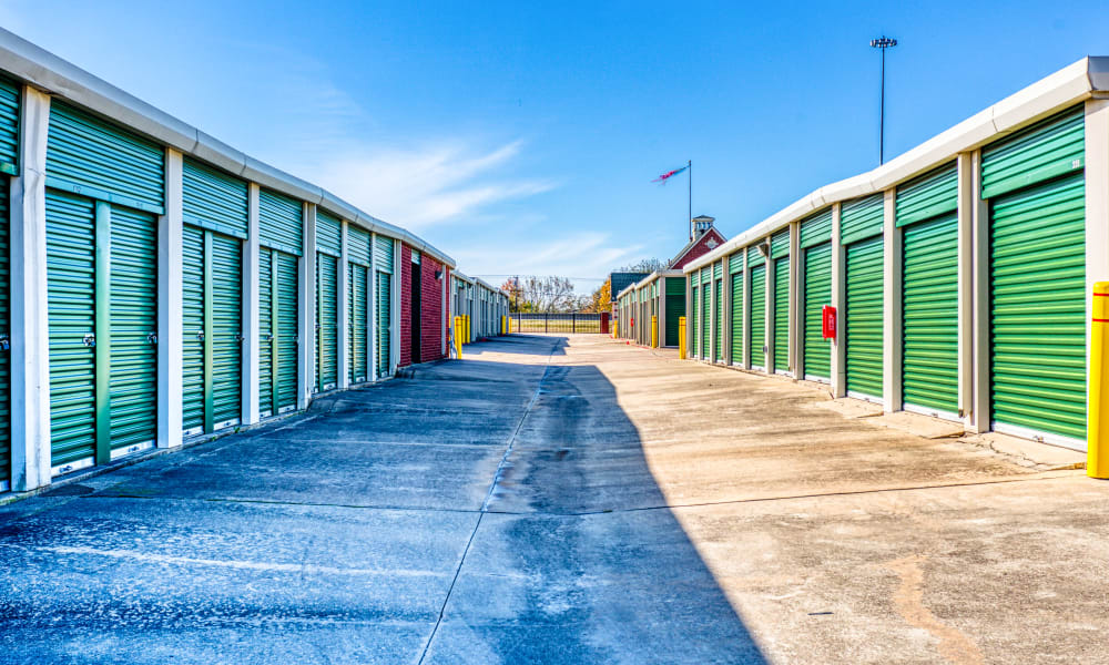 Driveway through storage units at Devon Self Storage in Greenville, Texas
