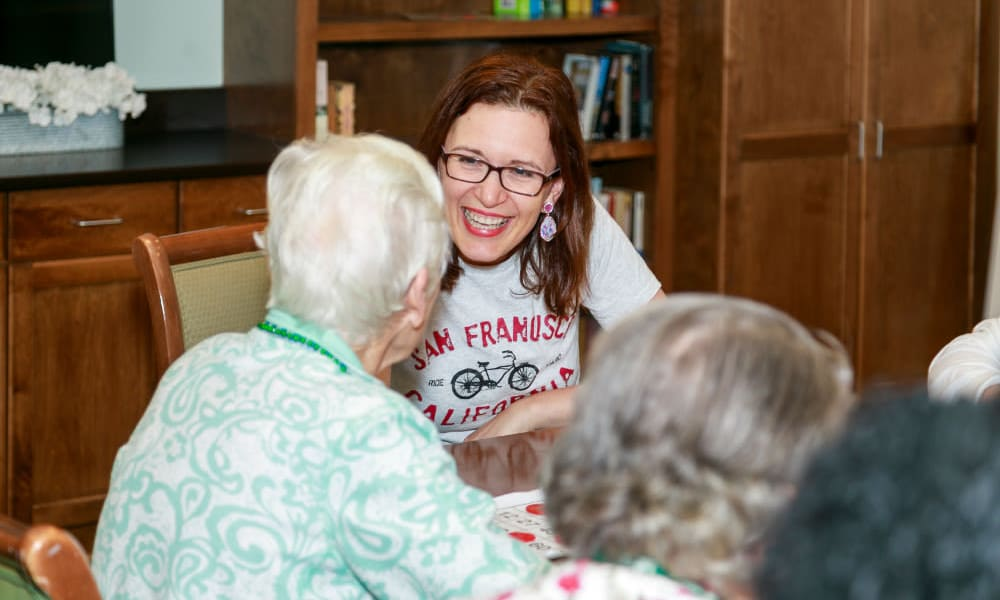 A resident with family at Traditions of Lansdale in Lansdale, Pennsylvania