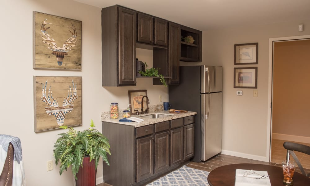 A resident room with a fridge at Inspired Living Sugar Land in Sugar Land, Texas