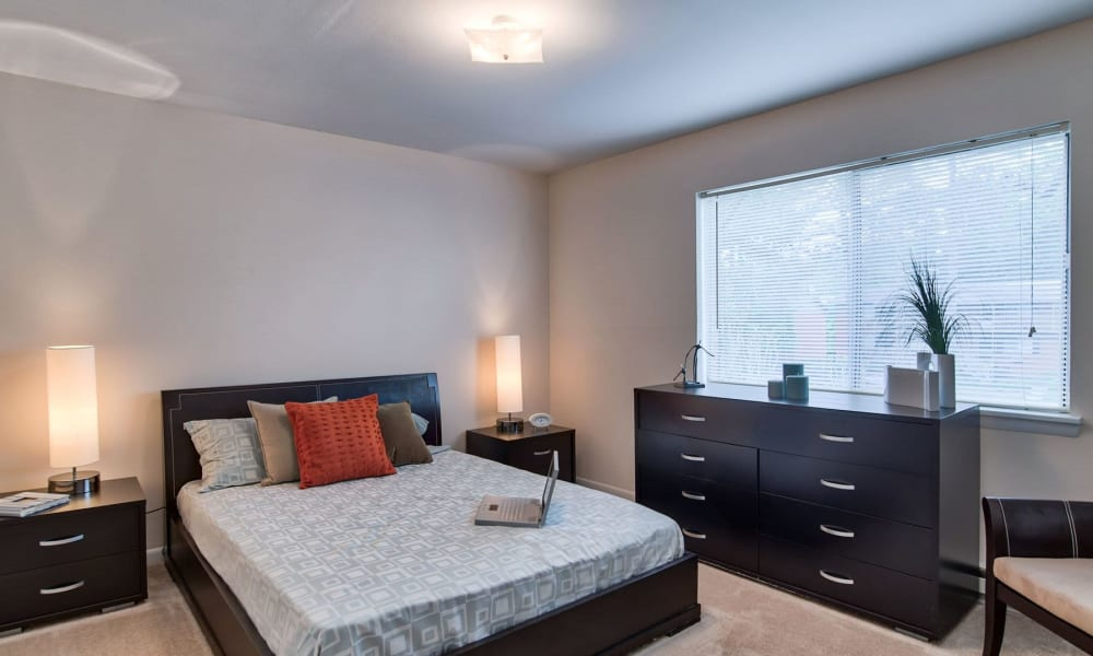 A spacious model bedroom at Carriage House Apartments in Smyrna, Georgia