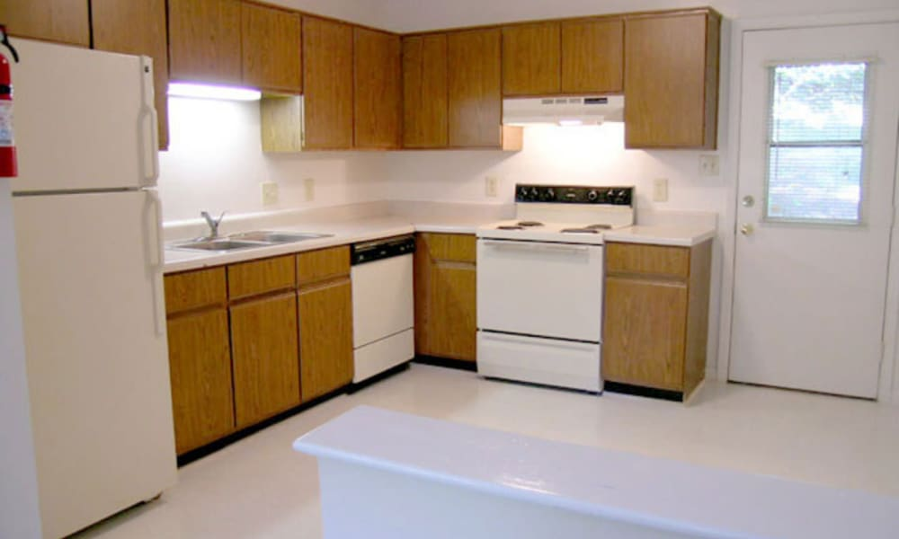 White kitchen appliances in an apartment at Carriage House Apartments in Smyrna, Georgia