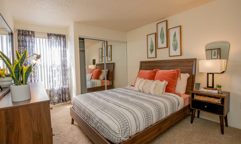 Bedroom with large window at Council Place Apartments in Oklahoma City, Oklahoma