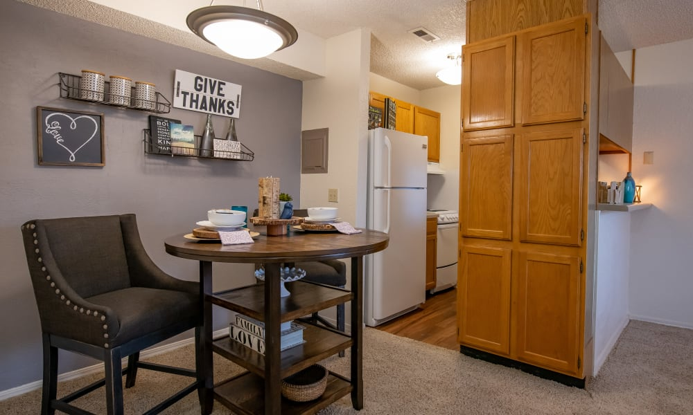 An apartment kitchen and dining room at Tammaron Village Apartments in Oklahoma City, OK