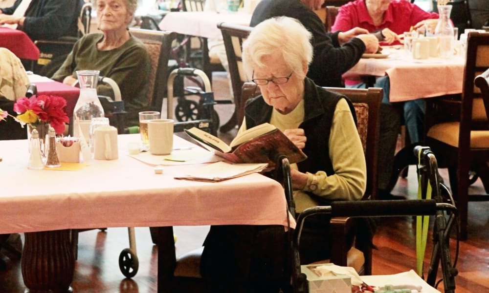 Resident reading at Heron Pointe Senior Living in Monmouth, Oregon