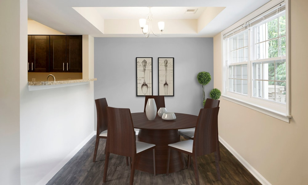 A decorated apartment dining room at Timberlawn Crescent in North Bethesda, Maryland