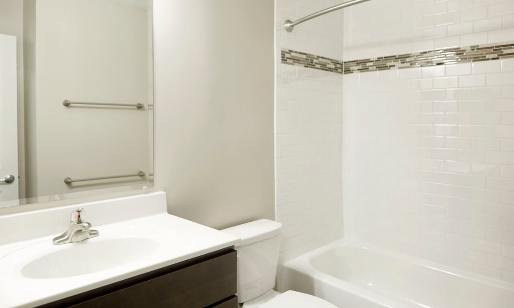 An apartment bathroom with backsplash at Timberlawn Crescent in North Bethesda, Maryland