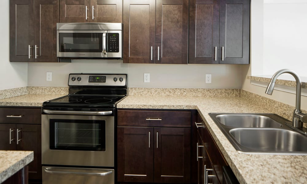 An apartment kitchen with new appliances at Timberlawn Crescent in North Bethesda, Maryland