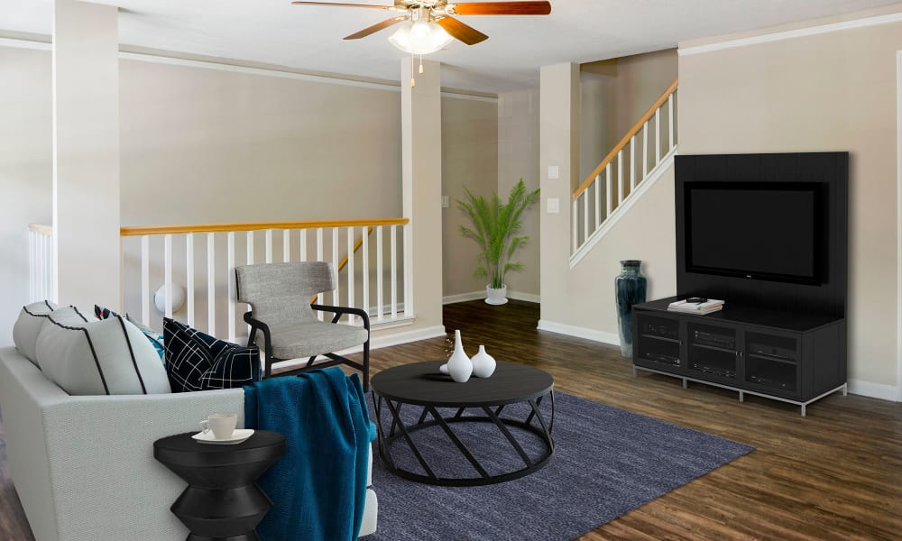 An apartment living room with television and couch at Timberlawn Crescent in North Bethesda, Maryland