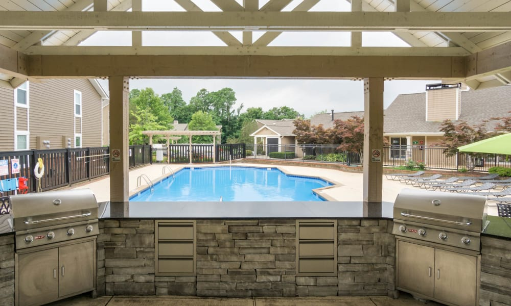 The grill and pool area at Paddock Club Apartments in Florence, Kentucky