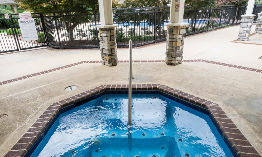 An outdoor hot tub at Paddock Club Apartments in Florence, Kentucky