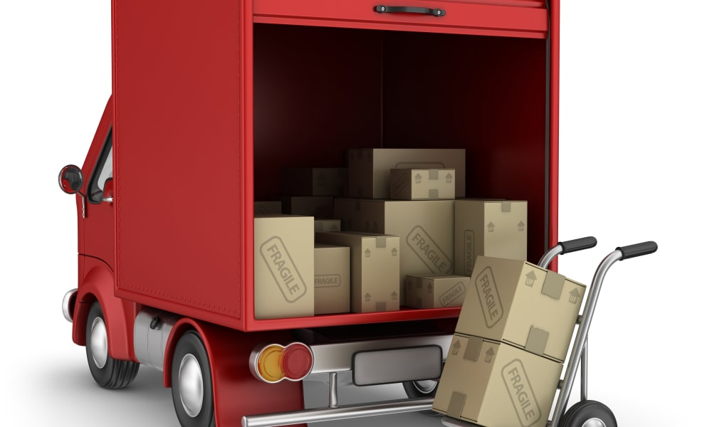 Red moving truck, dolly and boxes at Michigan Storage Centers in Oak Park, Michigan